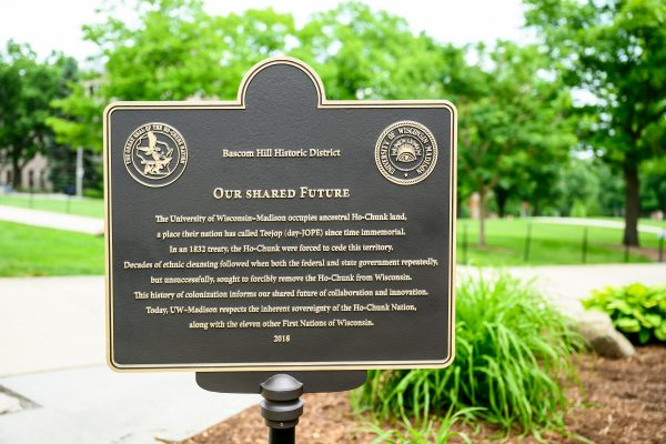 """An """"Our Shared Future"""" plaque, which makes clear that the university occupies ancestral Ho-Chunk land, is pictured on Bascom Hill at the University of Wisconsin-Madison on June 18, 2019."""