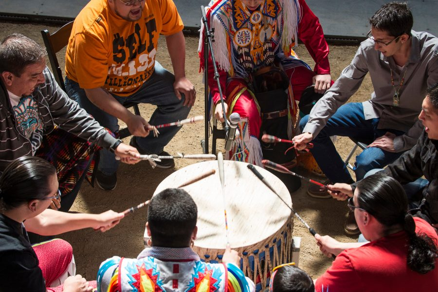 Members from numerous Native American tribes participate in a grand entry drumming and dance ceremony during a Spring Powwow at the Stock Pavilion at the University of Wisconsin-Madison on April 6, 2014.